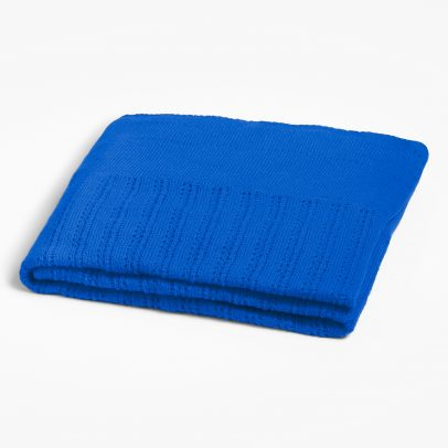 A folded triangular cashmere scarf with different patterns in the colour lapis on a white background.