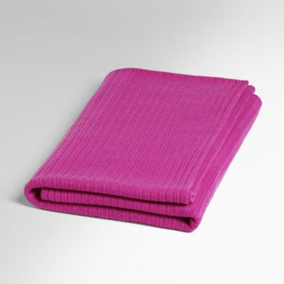 A folded cashmere scarf with a distinct pattern in pink on a white background.